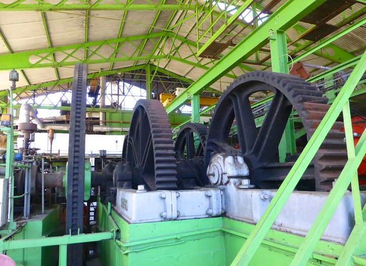 14. Massive gearworks drive crushers, conveyor belts, etc.
