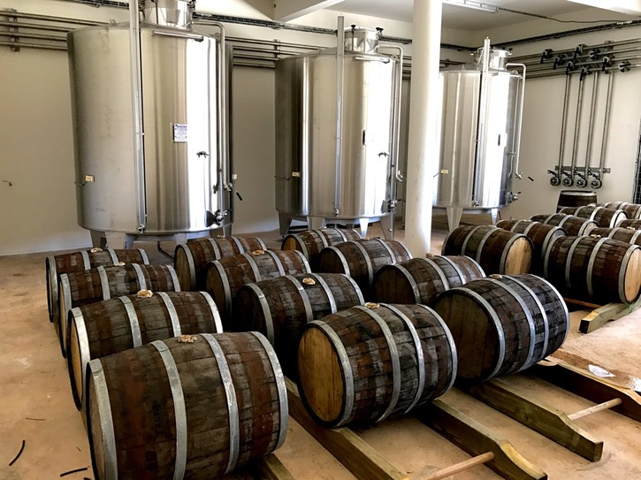 21. Seen below the main floor of the modern aging warehouse are these stainless s tell storage, resting.transfer tanks and some used Bourbon barrels aging some experimental -yet-to-be-released rhum.  It was an exciting tipple