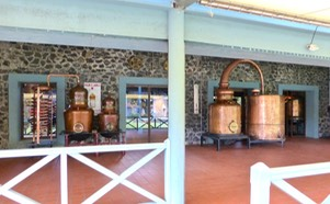 A couple of restored copper pot stills and retorts greet you upon entering Saint James' musée du rhum