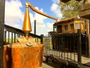 Lost Spirits copper pot still, lyne arm and condenser in daylight.  Handmade by the distiller himself.