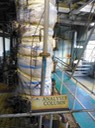 •The Ananlyser column, half of St. Lucia Distillers' two-column still, here seen with thermal wrap.