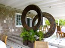 Wooden gears once used in the sugar mill are now artfully displayed at Montpelier Plantation Inn, Nevis.